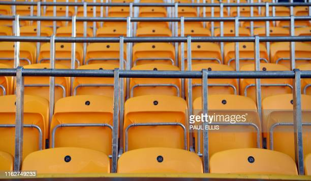 Seats with builtin safety barriers known as rail seating to allow safe standing are pictured in the stands ahead of the English Premier League...