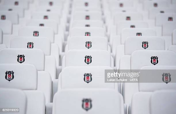 Seats with the emblem of Besiktas are seen prior to the UEFA Champions League match between Besiktas JK and SL Benfica at Vodafone Arena on November...