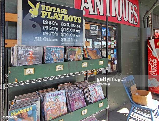 seattle antiques market - vintage playboy magazines - magazine rack stock photos and pictures