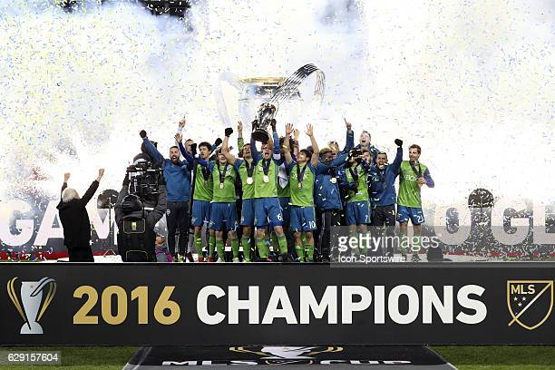 Seattle captain Osvaldo Alonso holds the Philip F Anschutz Trophy overhead while celebrating with his team Toronto FC hosted Seattle Sounders FC in...