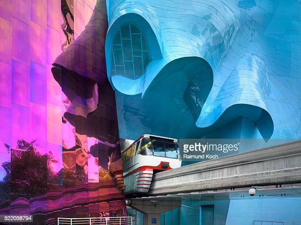 seattle center monorail exiting through the experience music project - monorail stock pictures, royalty-free photos & images