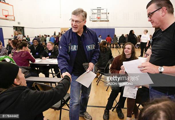 Seattle City Attorney Peter Holmes meets other caucusers during Washington State Democratic Caucuses at Martin Luther King Elementary School in...