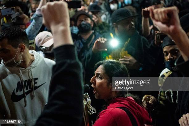 Seattle City Council member Kshama Sawant, a critic of Mayor Jenny Durkan and the Seattle Police Department, speaks as demonstrators hold a rally...