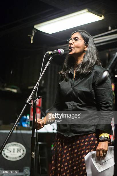 """Seattle City Council Member Kshama Sawant speaks at the """"15 Now"""" Benefit Show at El Corazn on September 26, 2014 in Seattle, Washington."""