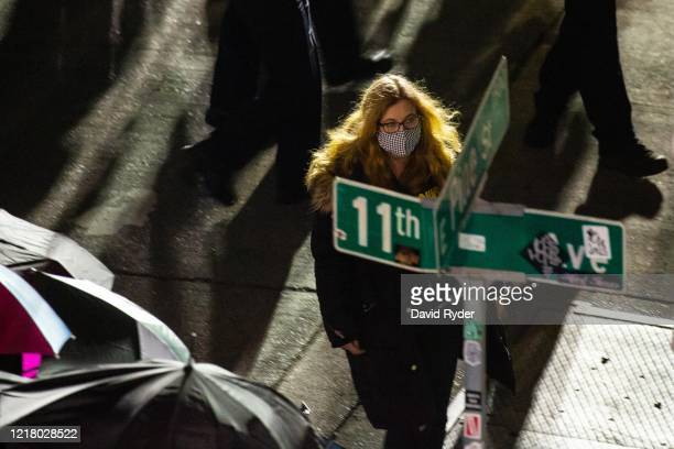 Seattle City Council member Lisa Herbold walks inside the secure police area as demonstrators face off with law enforcement personnel near the...
