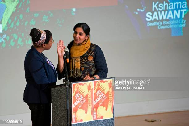 Seattle City Councilmember Kshama Sawant is sworn in during her inauguration and Tax Amazon 2020 Kickoff event in Seattle Washington on January 13...