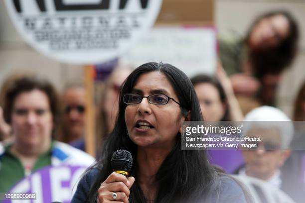 Seattle city councilmember Kshama Sawant speaks to everal hundred people gathered outside of City Hall, Tuesday, as part of a national day of action...