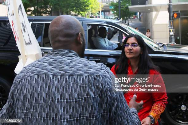 Seattle city councilmember Kshama Sawant speaks with Fasil Teka as Uber and Lyft drivers gathered outside City Hall, Thursday, to protest what they...