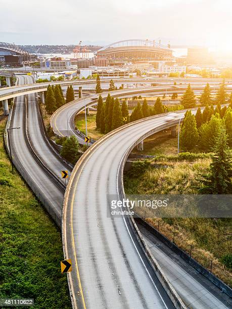 seattle commute. the seattle, washington skyline at sunset - flyover stock pictures, royalty-free photos & images