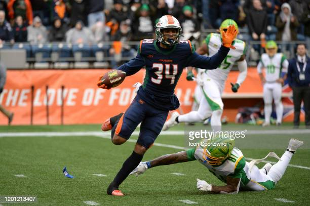 Seattle Dragons cornerback Jeremy Clark runs the ball back after his interception during an XFL football game between the Tampa Bay Vipers and the...