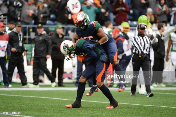 Seattle Dragons linebacker Nick Temple celebrates after cornerback Jeremy Clarks interception during an XFL football game between the Tampa Bay...