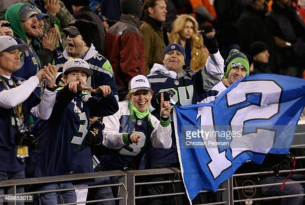 Seattle fans hold a 12th Man flag during Super Bowl XLVIII at MetLife Stadium on February 2 2014 in East Rutherford New Jersey