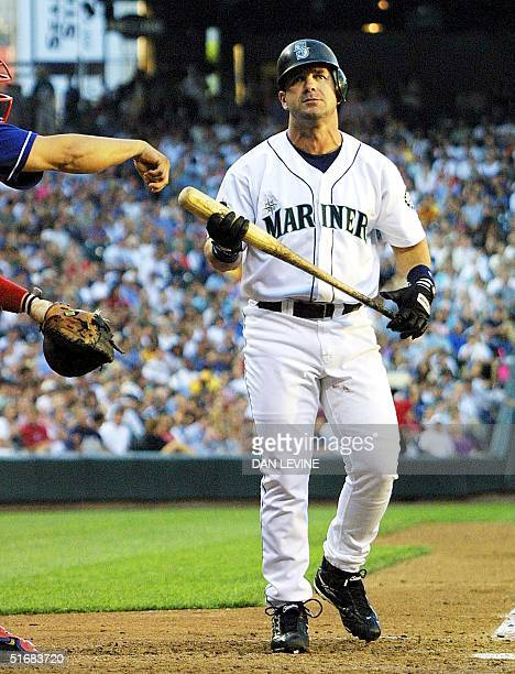 Seattle Mariner Edgar Martinez reacts in frustration after striking out in the fourth inning of play against the Texas Rangers in Seattle 24 July...