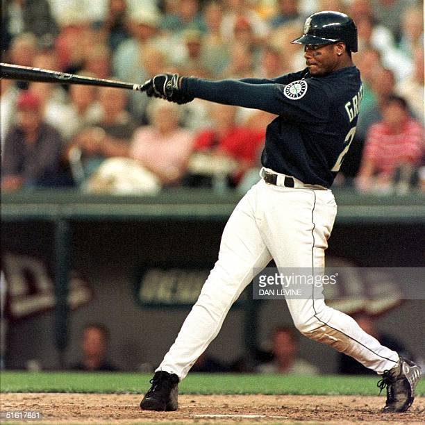 Seattle Mariner Ken Griffey Jr belts a two run home run during eighth inning action of his game against the Cleveland Indians in Seattle WA 22...