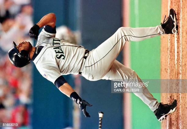 Seattle Mariner Ken Griffey Jr watches the flight of his home run that hit off Toronto Blue Jay pitcher Pat Hentgen in the sixth inning at Toronto's...