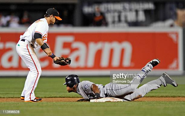 Seattle Mariners' Adrian Beltre right slides safely into second base under the tag of Baltimore Orioles' Brian Roberts in the sixth inning at Oriole...