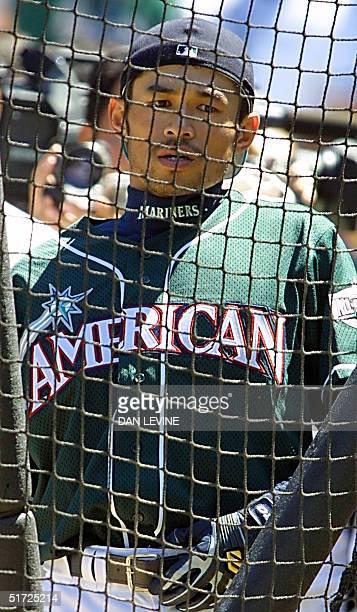 Seattle Mariners' AllStar centerfielder Ichiro Suzuki of Japan waits behind the batting cage during batting practice for the AllStar game 10 July...