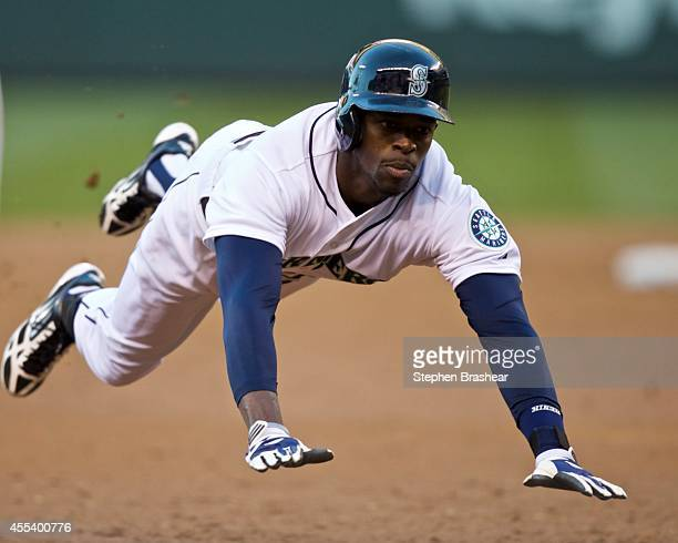 Seattle Mariners base runner James Jones slides safely into second base with a triple in the third inning of a baseball game against the Oakland...