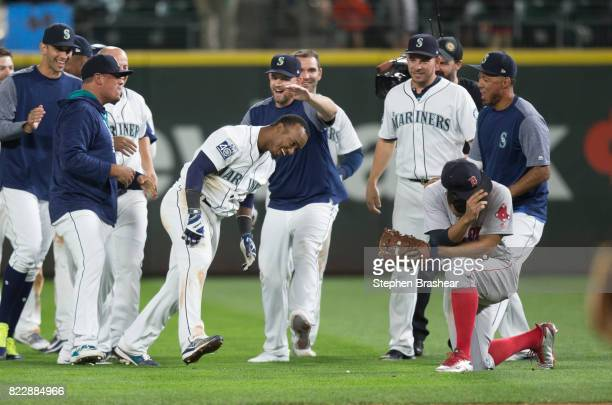 Seattle Mariners celebrate after Jean Segura center of the Seattle Mariners hit an RBIsingle off of relief pitcher Doug Fister of the Boston Red Sox...