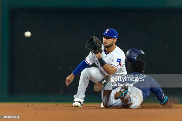 Seattle Mariners center fielder Dee Gordon dives into second base during the MLB American League West conference game against the Texas Rangers on...