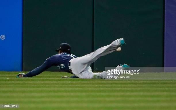 Seattle Mariners center fielder Dee Gordon misses the rbi double by Chicago White Sox designated hitter Matt Davidson during the first inning of...