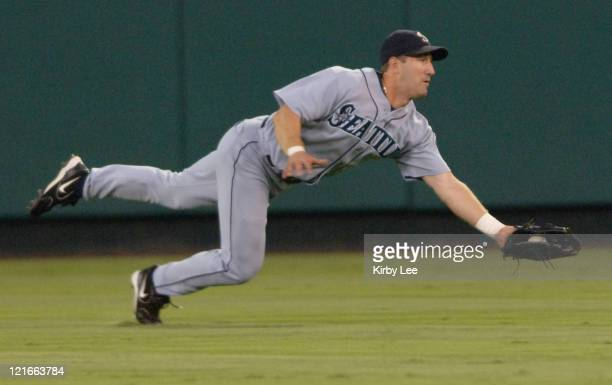Seattle Mariners center fielder Willie Bloomquist makes a diving catch in the second inning of 30 loss to the Los Angeles Angels of Anaheim at Angel...