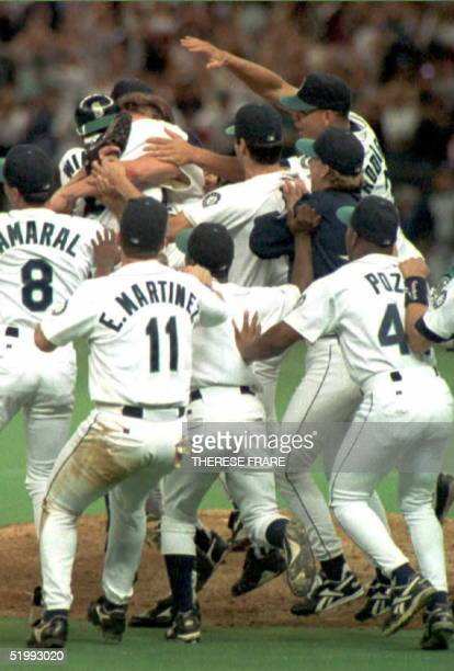 Seattle Mariners converge on the pitcher's mound to celebrate winning the title of American League West Champs after a 92 victory over the California...