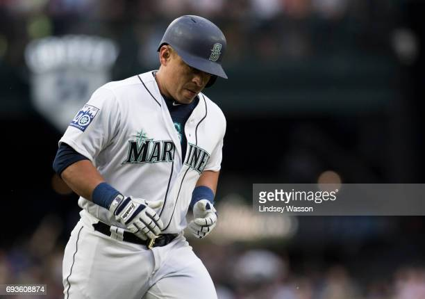 Seattle Mariners designated hitter Carlos Ruiz heads home after hitting a home run off of Minnesota Twins pitcher Adalberto Mejia in the third inning...