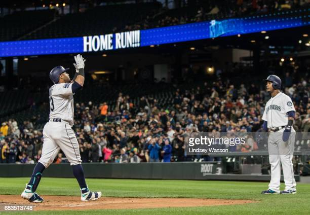 Seattle Mariners designated hitter Nelson Cruz celebrates his two run home run off of Oakland Athletics pitcher Sean Manaea with shortstop Jean...