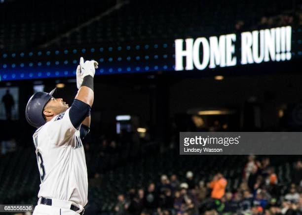 Seattle Mariners designated hitter Nelson Cruz celebrates his two run home run off of Oakland Athletics pitcher Sean Manaea in the second inning to...