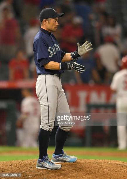 Seattle Mariners Ichiro Suzuki applauds from the mound after a 50 win over the Los Angeles Angels of Anaheim at Angel Stadium on September 14 2018 in...