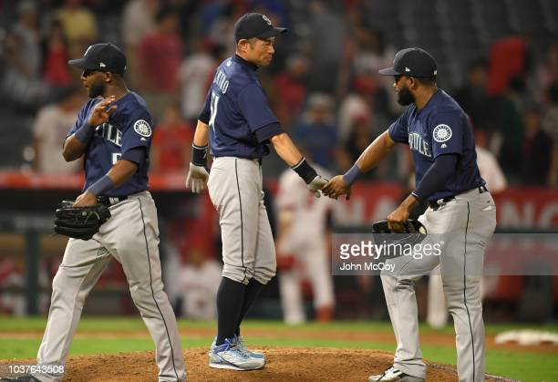Seattle Mariners Ichiro Suzuki shakes hands with Guillermo Heredia and Denard Span after the 50 win over the Los Angeles Angels of Anaheim at Angel...