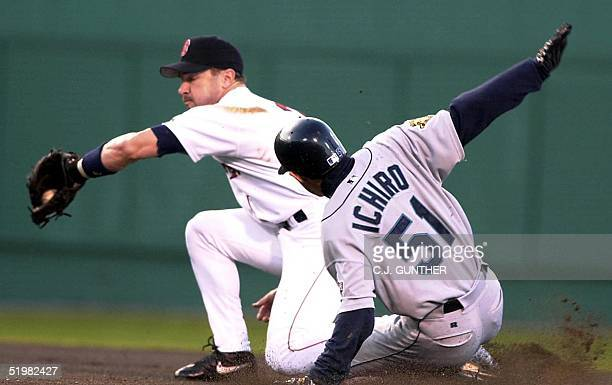 Seattle Mariners' Ichiro Suzuki slides safely into second base in the first inning before Boston Red Sox Mike Lansing at Fenway Park 09 May 2001 in...