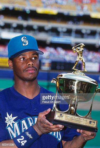 Seattle Mariners' Ken Griffey Jr. #24 holds a trophy after winning the 1994 All Star Home Run Derby with a total of seven home runs at Three Rivers...