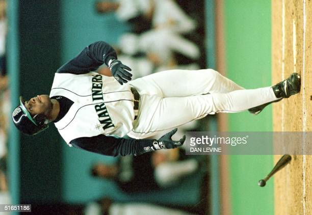 Seattle Mariners' Ken Griffey Jr belts his 56th homerun of the season during the second inning against the Oakland A's 27 September in Seattle WA AFP...
