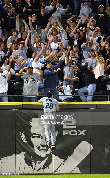 Seattle Mariners' Left Fielder Raul Ibanez leaps but can only watch Pablo Ozuna's twoout gametying pinch hit home run in the 9th inning land in the...