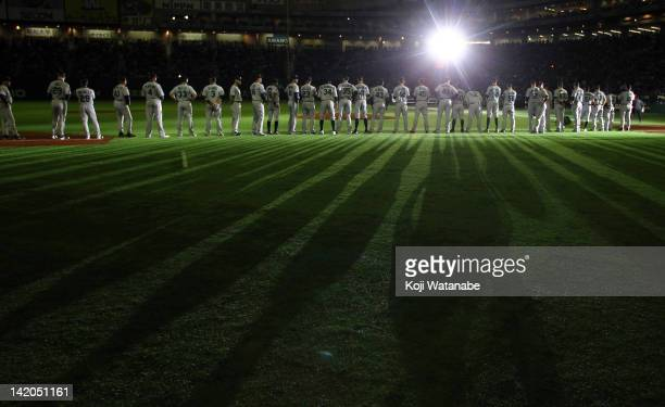 Seattle Mariners line up for national anthem during MLB match between Seattle Mariners and Oakland Athletics at Tokyo Dome on March 29 2012 in Tokyo...