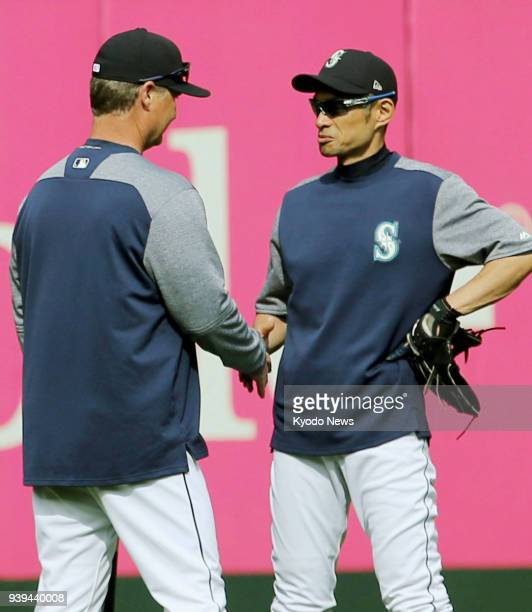 Seattle Mariners manager Scott Servais and outfielder Ichiro Suzuki shake hands during practice at Safeco Field in Seattle on March 28 a day before...