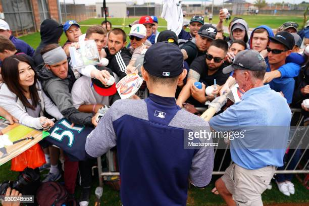 Seattle Mariners new signing Ichiro Suzuki signs autographs for fans during a spring training on March 10 2018 in Peoria Arizona
