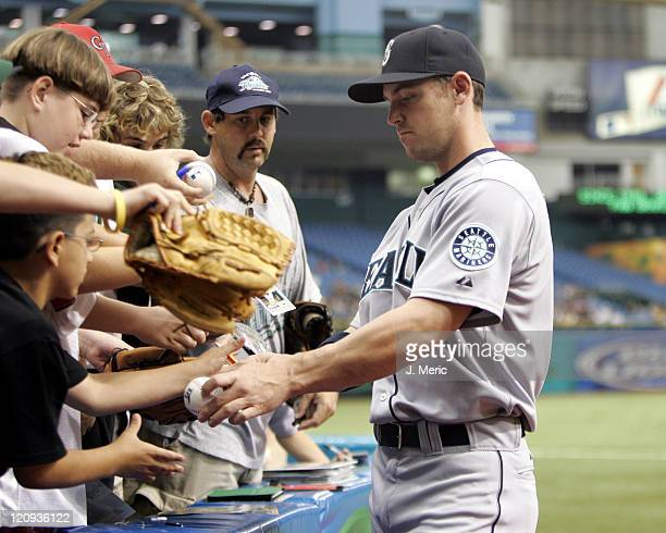 Seattle Mariners outfielder Jeremy Reed signs some autographs prior to Sunday's game against the Tampa Bay Devil Rays at Tropicana Field in St...