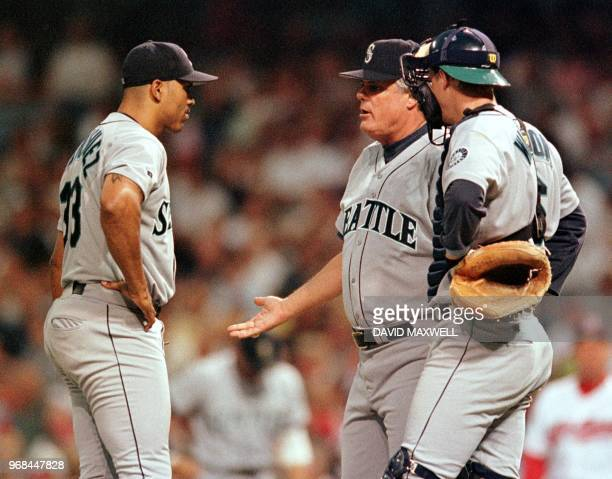 Seattle Mariners' pitcher Frankie Rodriguez gets a visit from manager Lou Piniella while pitching to Cleveland Indians batter David Justice in the...