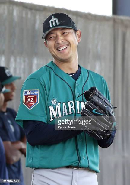 Seattle Mariners pitcher Hisashi Iwakuma smiles in the bullpen during training in Peoria Arizona on March 25 2018 ==Kyodo