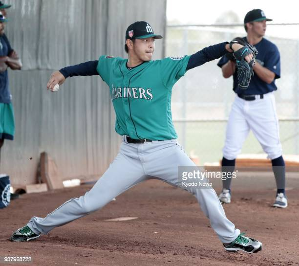 Seattle Mariners pitcher Hisashi Iwakuma throws in the bullpen during training in Peoria Arizona on March 25 2018 ==Kyodo