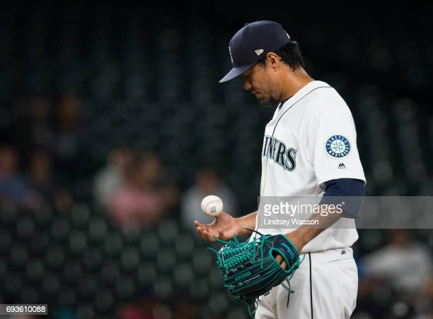Seattle Mariners pitcher Yovani Gallardo tosses the ball in his hand after giving up a there run home run to Minnesota Twins third baseman Miguel...