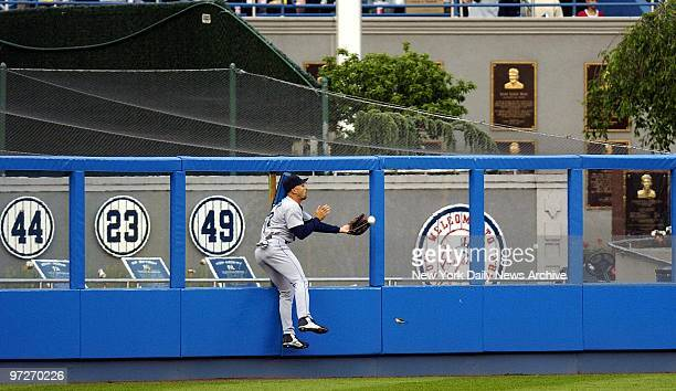 Seattle Mariners' Raul Ibanez drops ball to deep left center hit by New York Yankees' Alex Rodriguez in the first inning of game at Yankee Stadium...