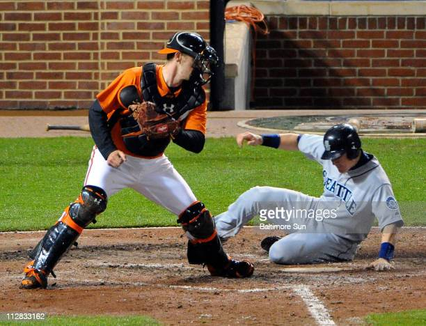 Seattle Mariners Rob Johnson right scored on a single by Michael Saunders in the sixth inning against Baltimore Orioles catcher Matt Wieters left at...
