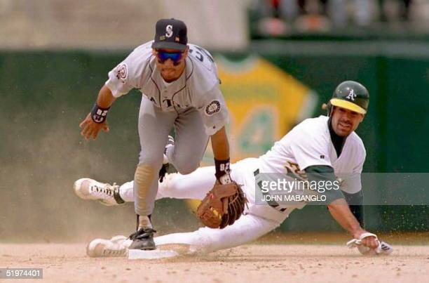 Seattle Mariners second baseman Joey Cora forces out Oakland A's player Brent Gates as he relayed a throw to first base for a double play 11 May in...