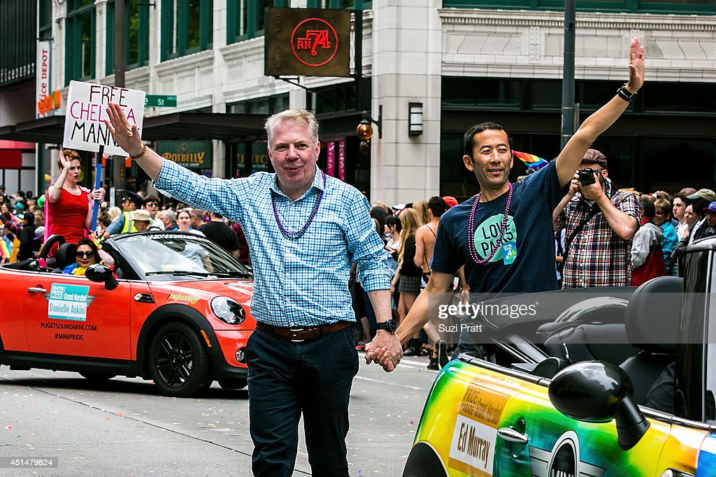 Seattle Mayor Ed Murray and his husband Michael Shiosaki makes an apperance in the 40th annual Seattle Pride Parade on June 29, 2014 in Seattle, Washington.