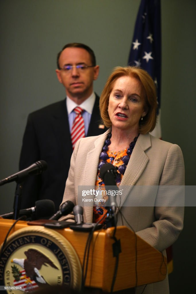 Seattle Mayor Jenny A. Durkan, and former U.S. Attorney, speaks at apress conference on the investigation into the murder of federal prosecutor Tom Wales on February 21, 2018 in Seattle, Washington. Behind her is U.S. Deputy Attorney General Rod Rosenstein.
