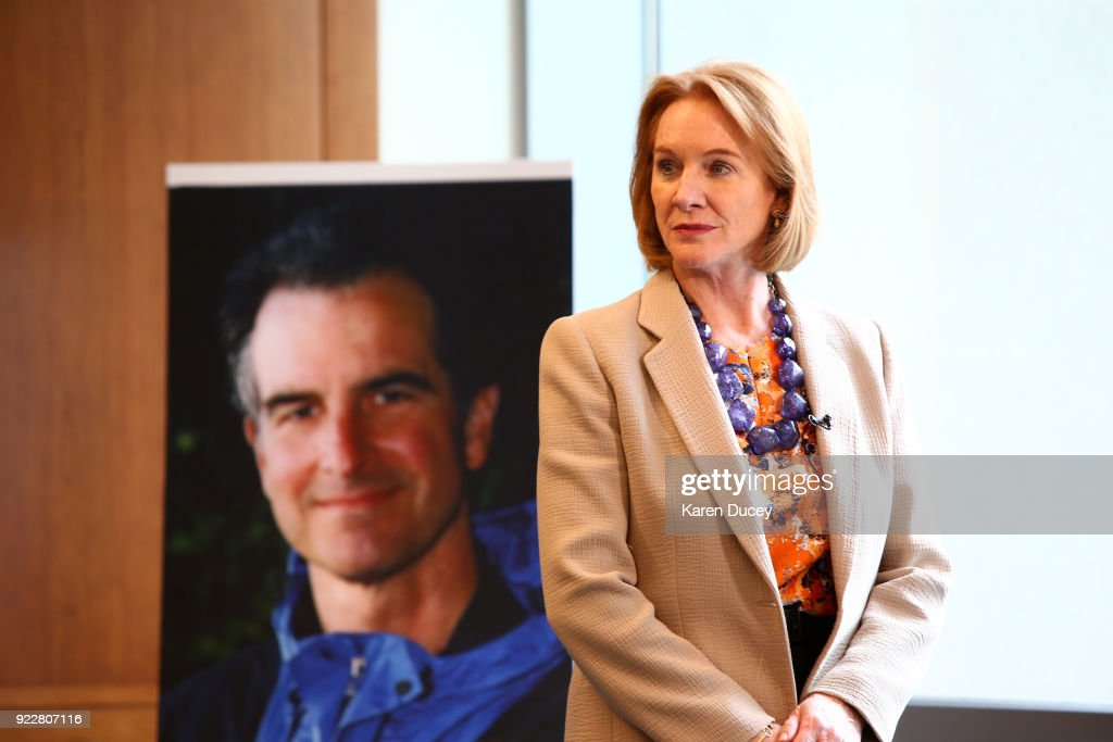 Seattle Mayor Jenny A. Durkan prepares to speak with a reporter with a photo of federal prosecutor Tom Wales behind her after a press conference on the investigation into his murder on February 21, 2018 in Seattle, Washington. The unsolved case now has a reward price tag of $1.5 million for leads in solvling the murder of the federal prosecutor.